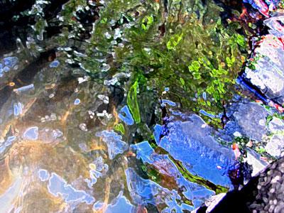 rippling pond at base of waterfall